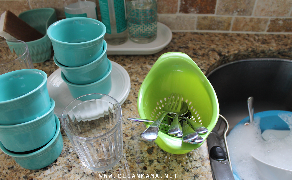 Rinse Silverware in a Colander While Prepping Dishes for Dishwasher via Clean Mama