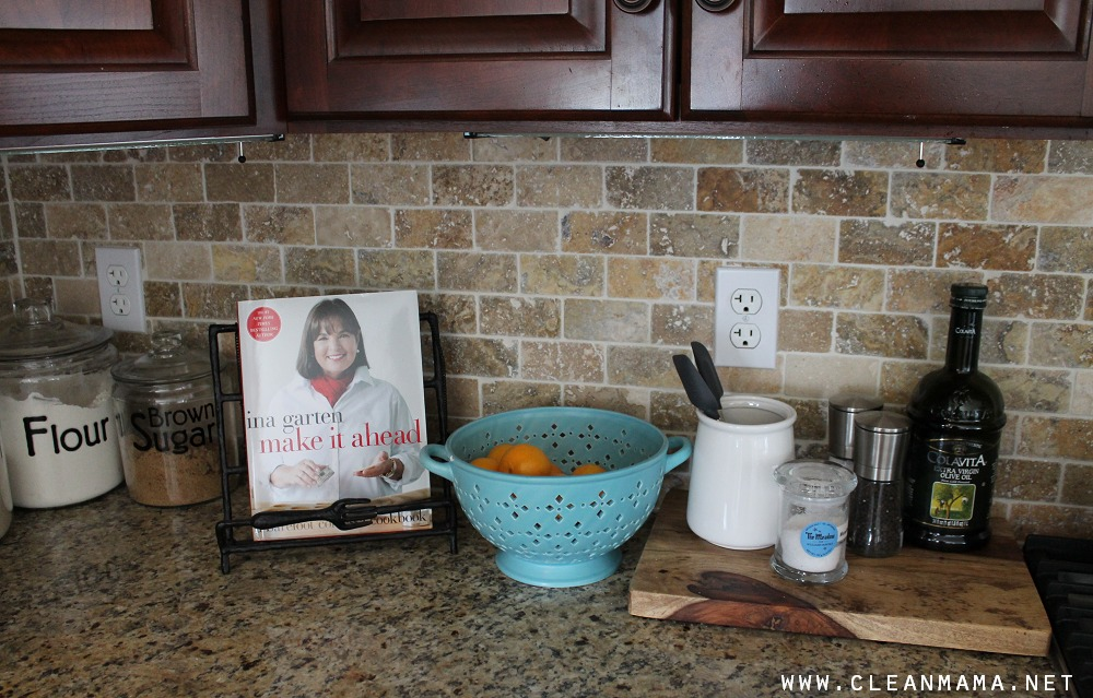 Use a cookbook holder via Clean Mama