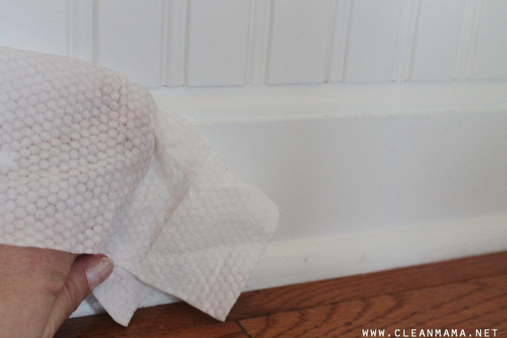 Cleaning Baseboards with Baby Wipes via Clean Mama