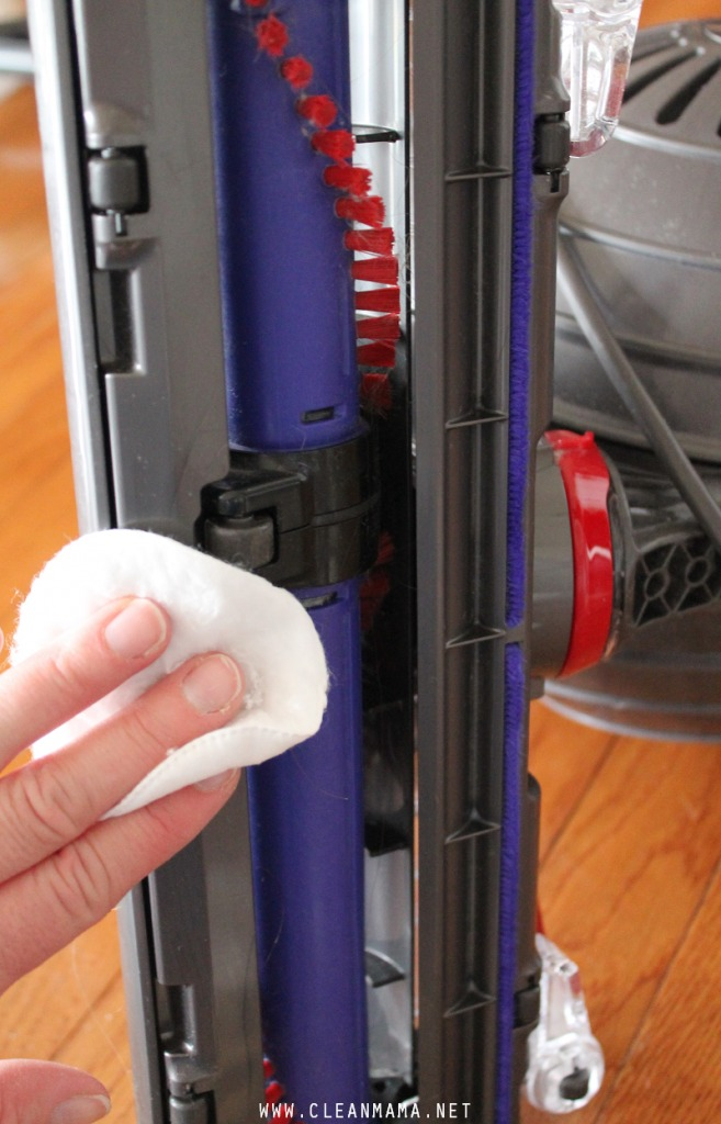 Wipe Bottom of Vacuum Cleaner with Rubbing Alcohol via Clean Mama